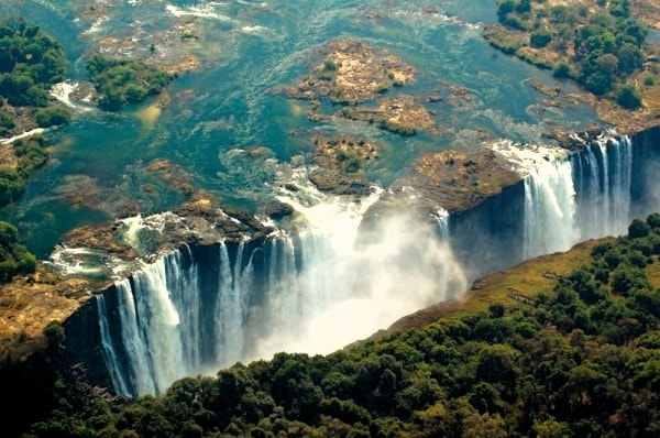 The Victoria Falls formed by water falling into a faultline. Image credit trekearth.com