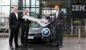 Harriet Green, Global Head of Watson IoT and Niklaus Waser, Head of Watson IoT Center in Munich present symbolic key to Marcus Raisch, Head of E-Mobility and Alexander Kraubitz, International Corporate Sales of BMW