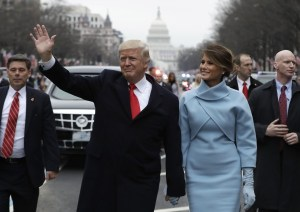 64443646_president_donald_trump_waves_as_he_walks_with_first_lady_melania_trump_during_the_inaugurat