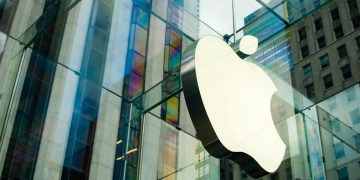 Close up shot of the Apple sign at the Apple Store in New York City