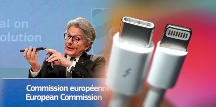 Representante de Bruselas durante la Comisión Europea, sosteniendo un celular en la mano apuntando hacia el puerto de carga