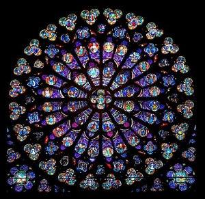 Par son plan comme par chacune de ses trois faces ornées d'une rosace, Notre- Dame incarne le schéma régulateur de la ville.