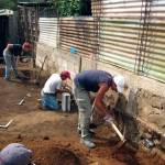 Volunteers helping with the construction of a house in San Juan del Obispo