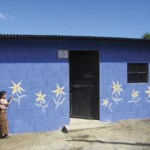 A young girl decorates her family's new home.