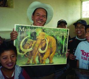 Caretaker Alvarado gives museum  tours to school children.