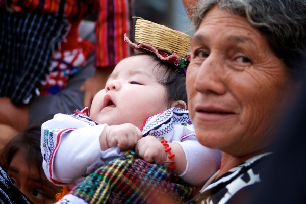 Grandmother and her granddaughter bonding for the Feast of Our Lady of Guadalupe in Antigua Guatemala (photo by Rudy Girón)