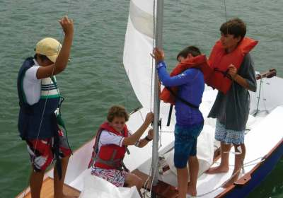 A group of future sailors learn the craft through hands-on experience.