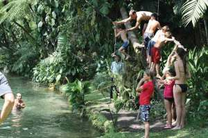 Rope swinging into the swimming pond
