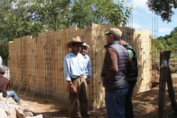 Project Manager and Engineer at site of water distribution tank