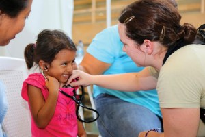 Comfort Heart: A girl listens to her own heartbeat during a medical checkup at Complejo Deportivo de Puerto Barrios. (u.s. army photo by PFC. Tomarius Roberts)