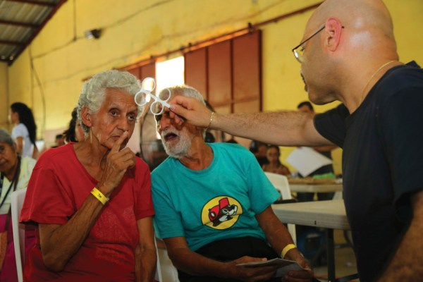 Comfort Optical: A patient receives an eye exam at a medical site set up at Casa Social Del Maestro Prof. Leopoldo in Puerto Barrios. (U.S. Army photo by PFC. Tomarius Roberts)