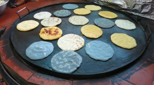 Pupusas are made using black, white and yellow corn dough a la plancha (Kerstin Sabene)