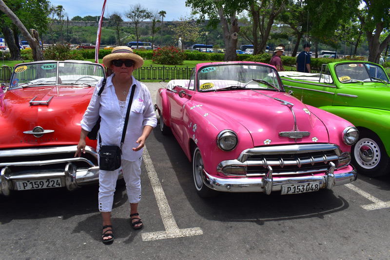 Amalia checks out some classic Cuban cruisers
