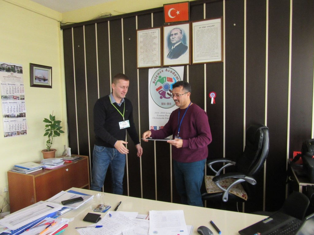 68. Ali Çetinkaya Ortaokulu school's headmaster giving the certificate to Polish coordinator