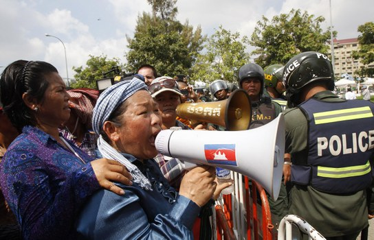 Cambodian protesters near the Australian Embassy in Phnom Penh, Cambodia, in a Sept. 26, 2014, file photo.  Credit: AP