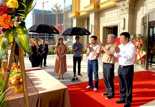 Rithy Samnang, third from right, and Xu Aimin, right, attend the opening ceremony in December 2019 for their KB Hotel & Casino on Xu Aimin Avenue, near Otres beach, Sihanoukville. Credit: MAX Media