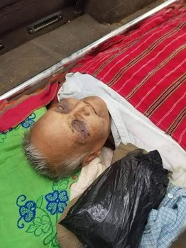 The body of Kan Htauk lies at his home after he death from injuries he received during an interrogation by military authorities, Aug. 21, 2021. Citizen journalist