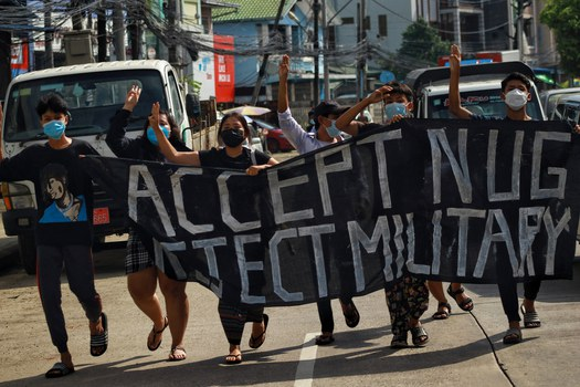 Youths march in support of the National Unity Government's declaration of war on the junta with a banner reading 'Accept NUG, Reject the Military' in Yangon, Sept. 7, 2021. RFA