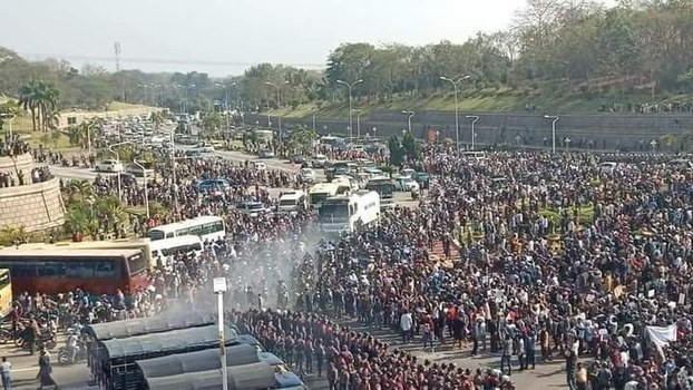 Protesters crowd an intersection in Nyapyitaw, Myanmar's capital and third-largest city, Feb. 8, 2021.
