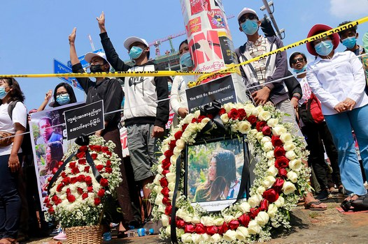 Protesters hold banners commemorating 20-year-old Mya Thwe Thwe Khine, the first protester killed in nearly three weeks of demonstrations against Myanmar's military coup, Yangon, Feb. 20, 2021. Credit: RFA