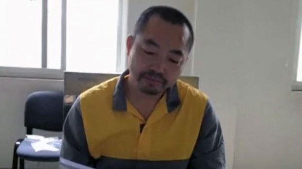 被关押的中国人权律师丁家喜(推特图片)