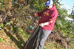 Man cleaning yard