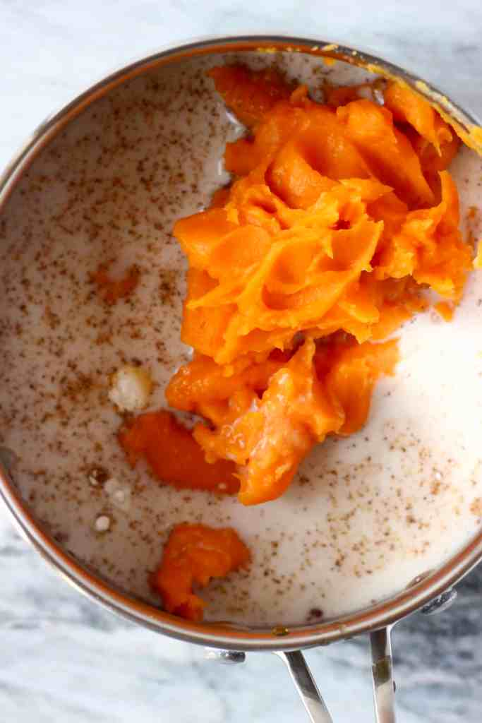 Sweet potato purée, milk and spices in a silver pan