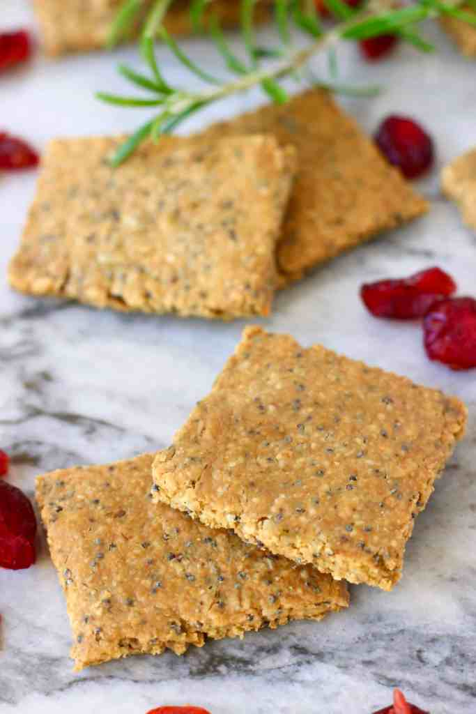 Four brown square crackers on a marble background