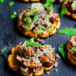 Quinoa stuffed delicata squash rings with mushrooms, cranberries, and pecans! Packed full of flavor and simple to make. Vegan, low carb, paleo, gluten free friendly recipe.
