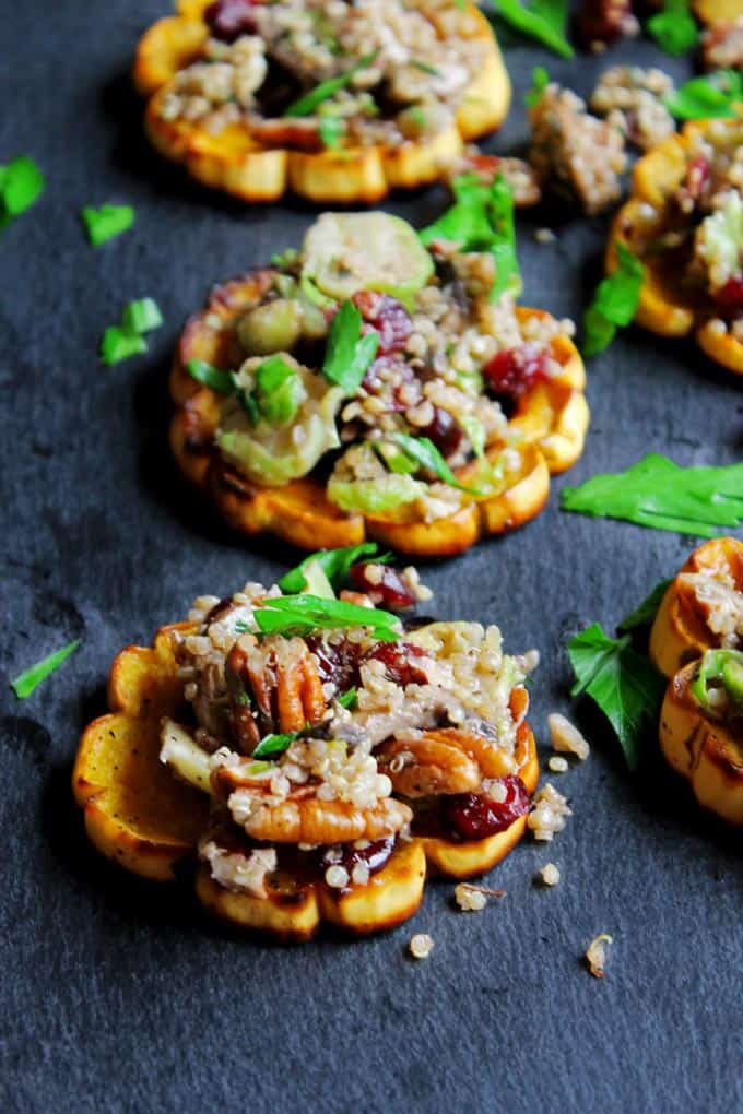 Quinoa stuffed delicata squash rings with mushrooms, cranberries, and pecans! Packed full of flavor and simple to make. Vegan, paleo, gluten free friendly recipe.