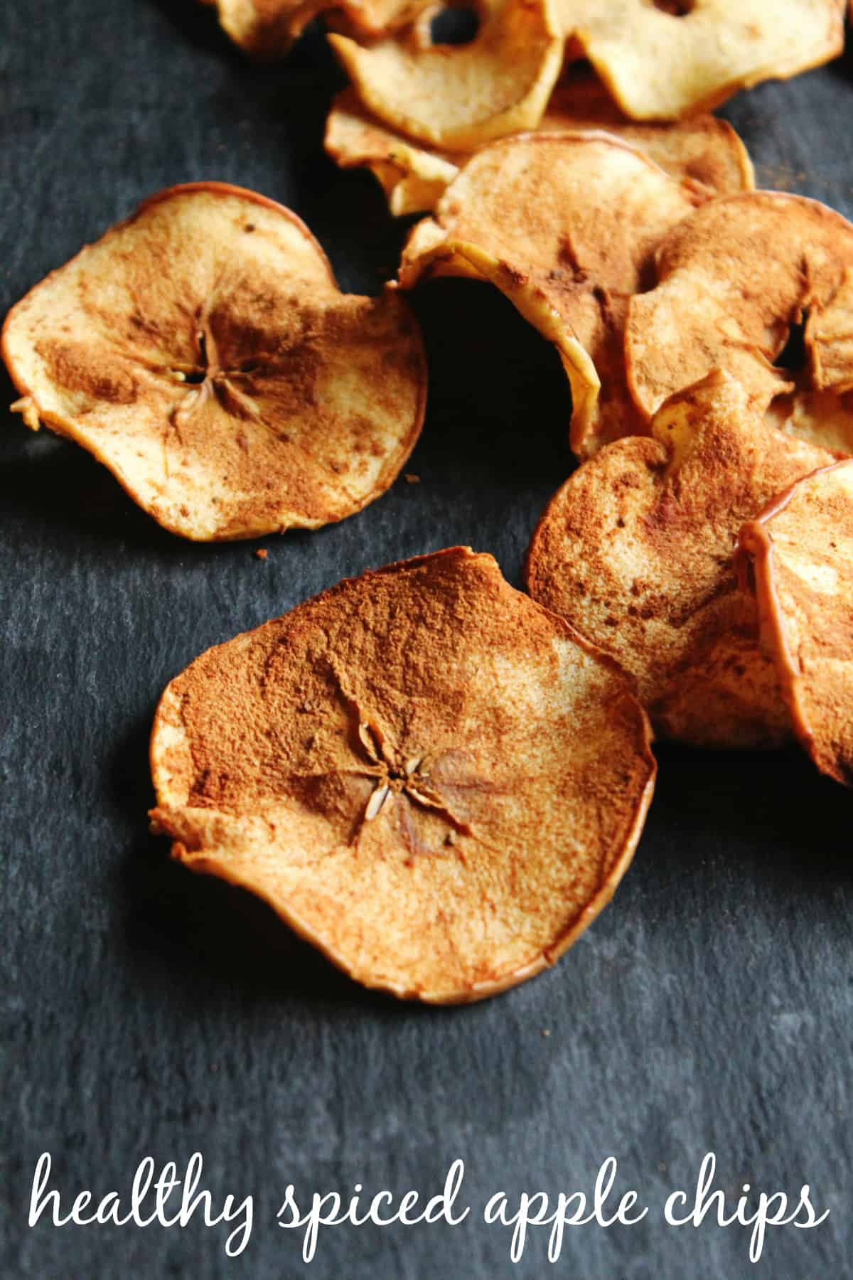 Healthy spiced apple chips! These easy homemade apple chips are the perfect snack for almost any diet! Vegan, gluten free, sugar free, paleo.