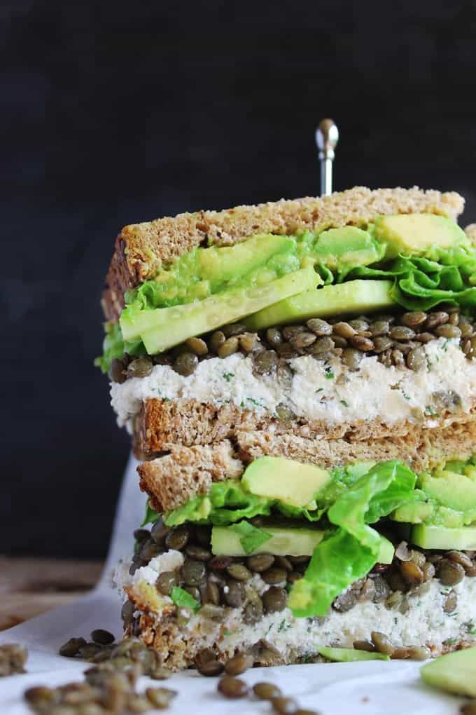 Spring green lentil sandwiches with walnut herb ricotta recipe! Delicious, vegetarian sandwiches with french green lentils, cucumber, avocado, and a walnutty herby ricotta cheese. SOOOO GOOD!