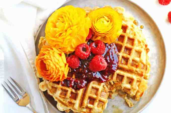 Cheesy green chile cornbread waffles with raspberry preserves