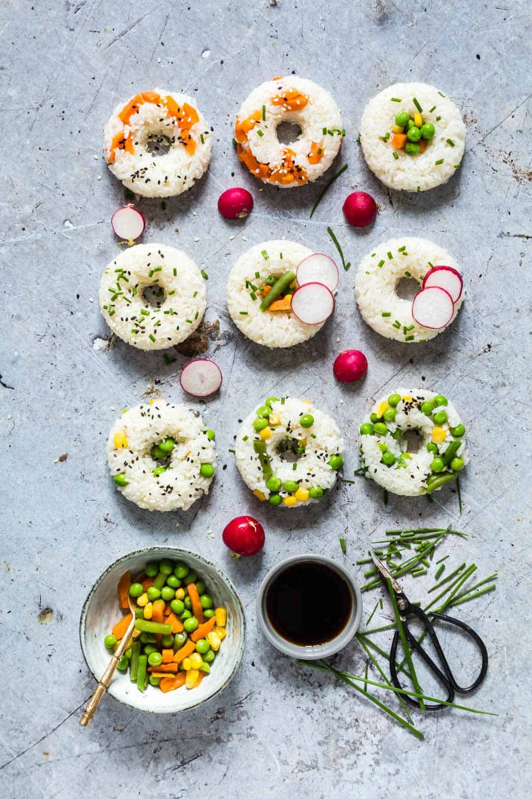 Vegetable sushi donuts + 15 Farmers market recipes to make in May! Delicious, vegetarian, (mostly) healthy spring/summer recipes made with fresh, seasonal produce from your local farmers market or CSA bin. Eat local! // Rhubarbarians