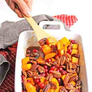 Vegan maple pecan roasted butternut squash and cranberries! Simple, clean, Thanksgiving, Christmas, fall, holiday side dish. // Rhubarbarians #sidedish #thanksgiving #christmas #holiday #vegan #butternutsquash #fallrecipe
