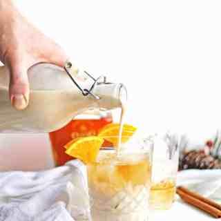 Orange spice vegan coquito recipe! Dairy free and egg free way to enjoy Puerto Rican eggnog. // Rhubarbarians // coconut eggnog / vegan eggnog / holiday drinks / christmas cocktail / holiday cocktail / #christmas #christmascocktail #holidaycocktail #eggnog #coquito #vegan