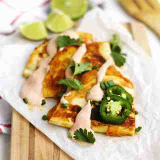 Cheesy pumpkin quesadillas with smoky sour cream recipe! These vegetarian, fall inspired pumpkin quesadillas are made with lots of Mexican spices and are super quick and easy to make. // Rhubarbarians // fall dinner recipe / fall lunch recipe / savory pumpkin recipe / virtual pumpkin party / #pumpkin #quesadillas #virtualpumpkinparty #rhubarbarians