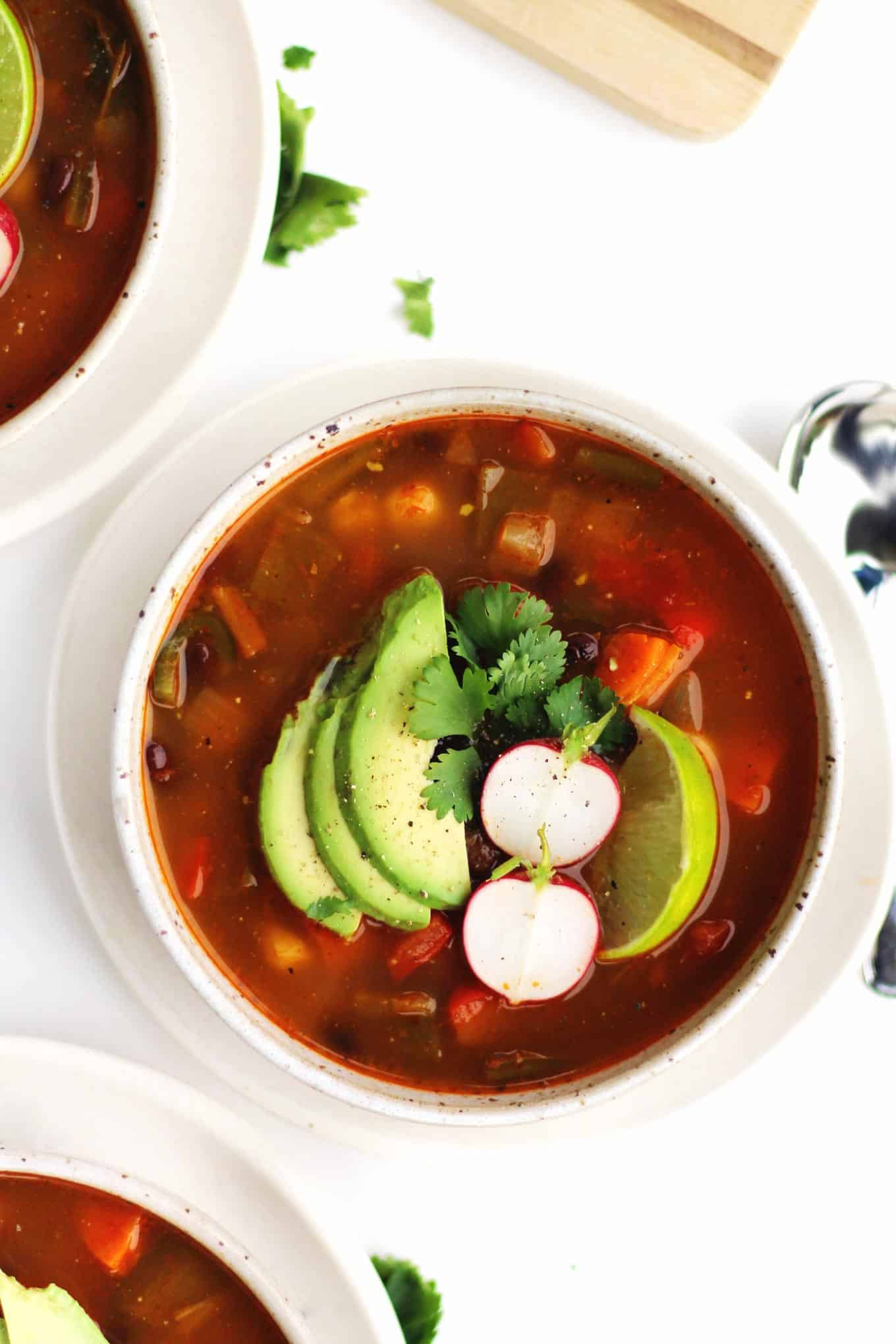 vegan posole in white bowl