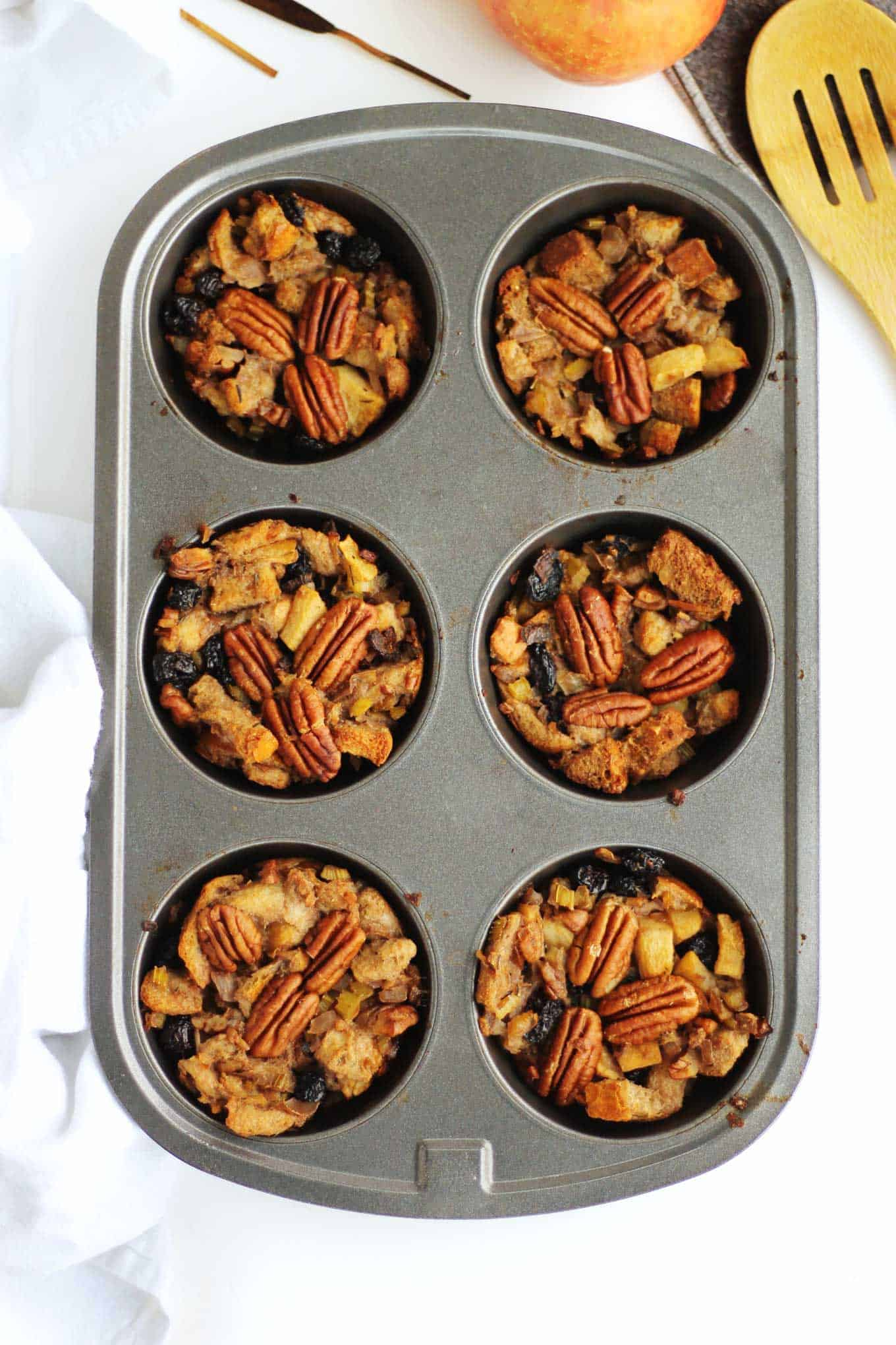 stuffing muffins in a muffin tin
