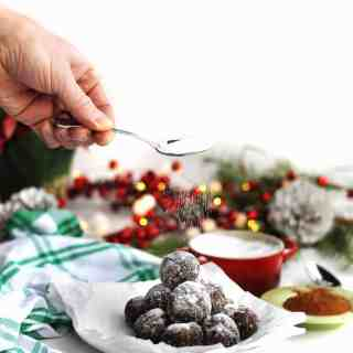 dusting sugar on sugar plums