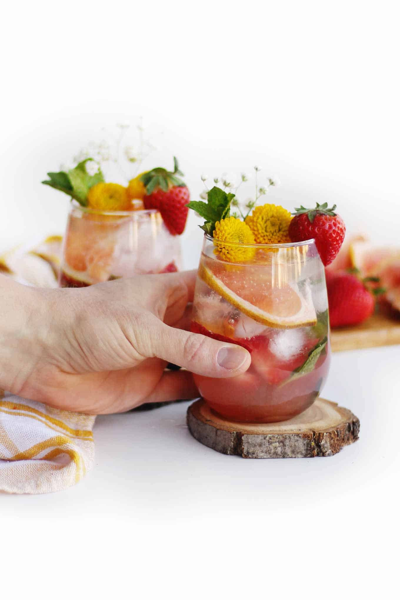 strawberry mojito with hand