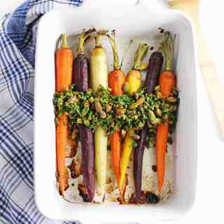 roasted carrots in a white pan