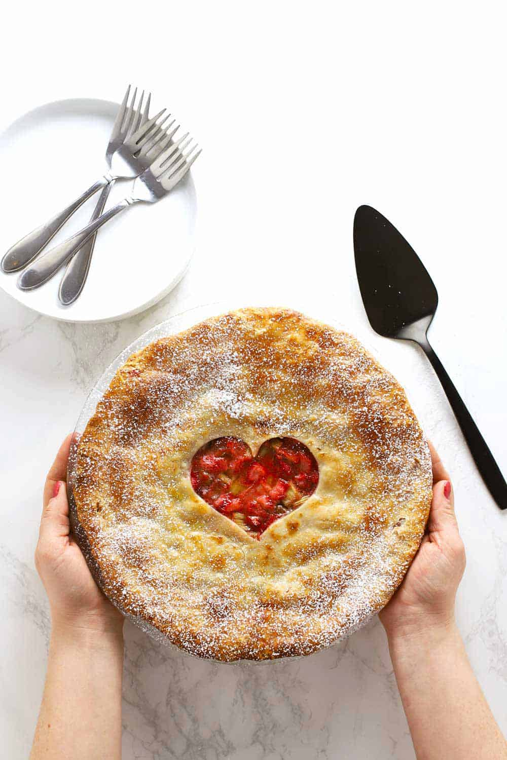 strawberry rhubarb pie with hands
