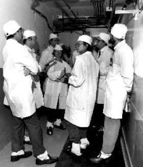 Karen (middle, facing camera) as part of a first ever media tour of the Hanford PUREX plutonium plant in 1985.