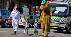 Tyson the Wombat, VRA's Mascot, accompanied by VRA Junee Rescue Branch volunteer Lee Rowe and her grandchildren leads the inaugural Rhythm n Rail Street Parade.
