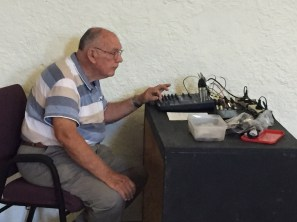 John McLaren monitoring sound levels at the Junee Combined Church Service