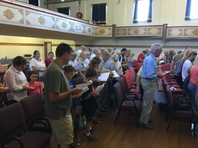 Parishioners signing hymns at the Junee Combine Church Service held at the Athenium Theatre