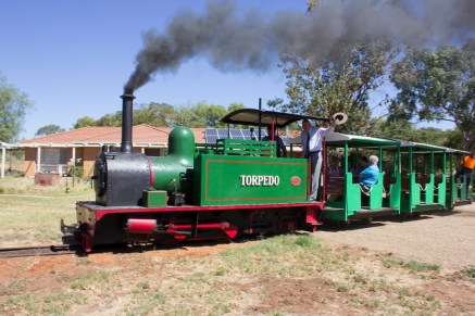 The Hon. Tim Fischer AC enjoying a ride in the restored 1915 Hunslet steam locomotive at Pete's Hobby Rail