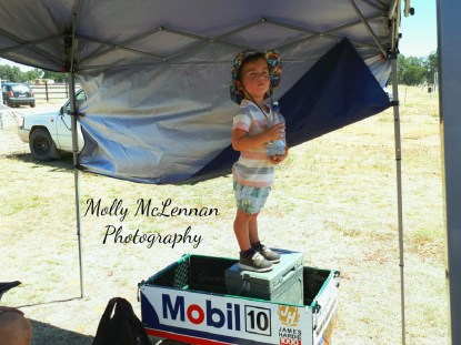 A budding young racer enjoys a slice of the Vintage Speedway action... at Illabo Motorsports Park