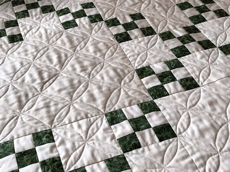 Green and White Quilt with Orange Peel Quilting